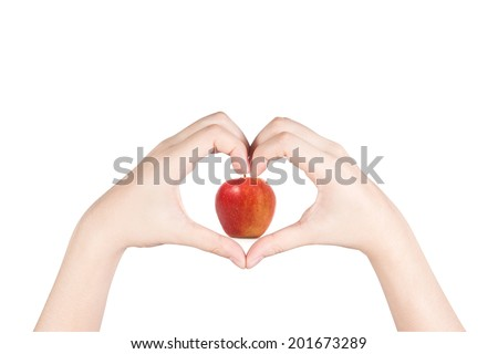 Woman hand with heart shape holding red apple isolated on white background. - stock photo