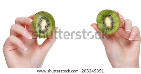 woman hand with kiwi fruit isolated on white - stock photo