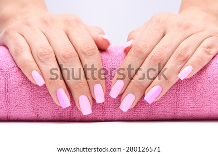woman hand with lovely pink manicure