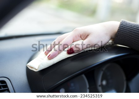 Woman hand with microfiber cloth cleaning car.  - stock photo