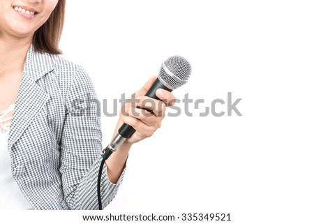 Woman hand with microphone isolated on white background - stock photo