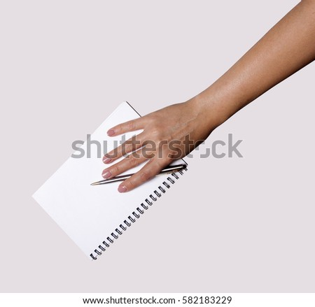 Woman hand with pen and notebook