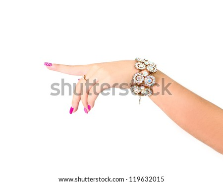 Woman hand with pink manicure pointing to the left - stock photo