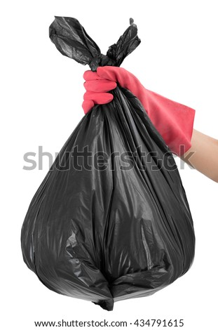 woman hand with red glove holding full Garbage bag, Isolated  on white background. - stock photo