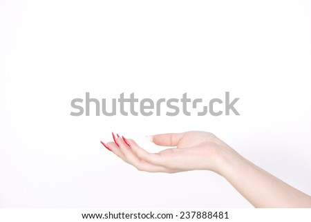 Woman hand with red nails gestures - stock photo