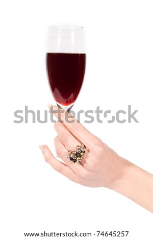 Woman hand with ring holding glass of wine on white