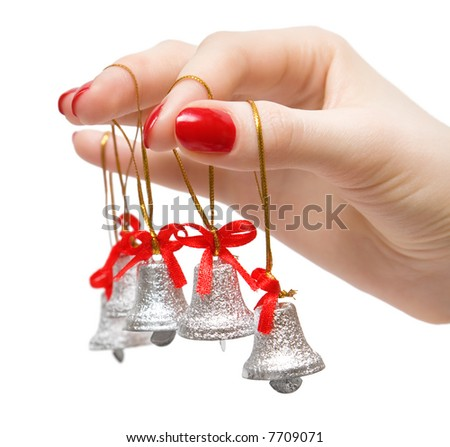 Woman hand with small bells on fingers. Isolated on white. - stock photo