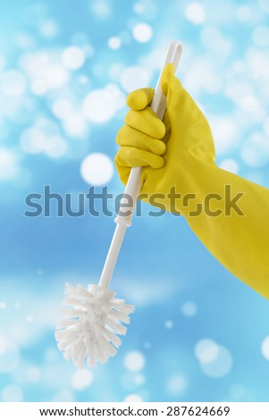 Woman hand with toilet  brush cleaning - stock photo