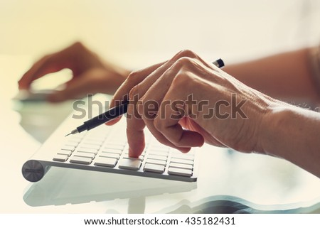 Woman hand working computer - stock photo