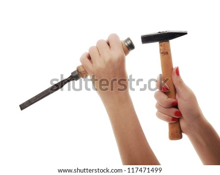 woman hand working with hammer and chisel - stock photo