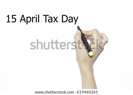 woman hand writing 15 april tax day