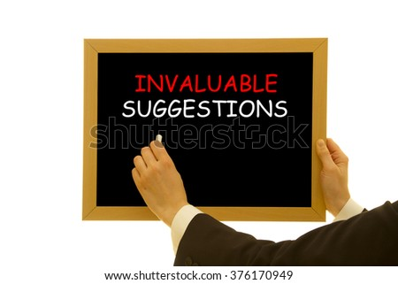 Woman hand writing Invaluable Suggestions on a small blackboard isolated on white background. - stock photo