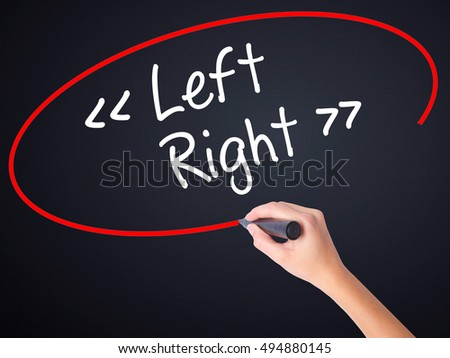 Woman Hand Writing Left - Right on blank transparent board with a marker isolated over black background. Stock Photo