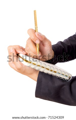 woman hand writing on notebook - stock photo