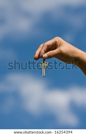 woman handing another woman keys to a house