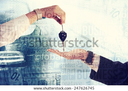 Woman handing man car key. Concept of buying new car. - stock photo
