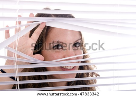 woman hands apart on the window blinds - stock photo
