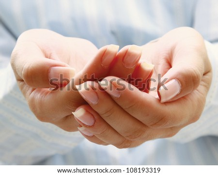 Woman hands as if holding something - stock photo
