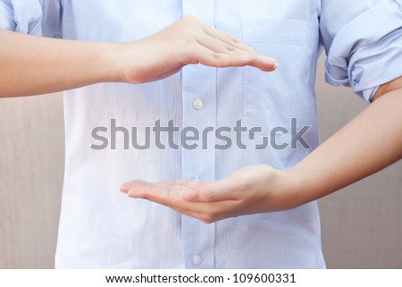 Woman hands as if holding something. Focus on finger-tips - stock photo