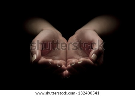 Woman hands begging with outstretched hands. Hands forming a cup. - stock photo