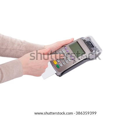Woman hands (beige sleeves) dials pin code on pin pad  of credit card machine (pos terminal) with inserted blank white credit card isolated on white