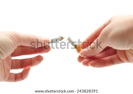 woman hands breaking a cigarette over white background - stock photo