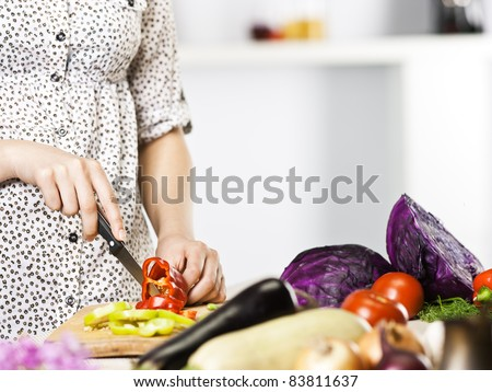 woman hands cooking vegetables - stock photo