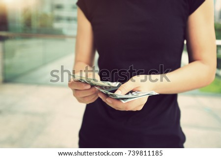 woman hands counting money in the city