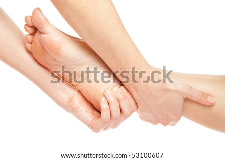 Woman hands giving a gentle foot massage isolated on white - stock photo