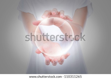 Woman hands hold empty bubble  over body - stock photo
