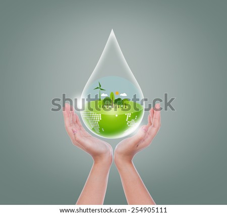Woman hands hold water drop of eco friendly earth - stock photo