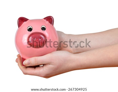 Woman hands holding a pink piggy bank isolated on white background - stock photo