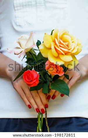 Woman hands holding bouquet of roses - stock photo