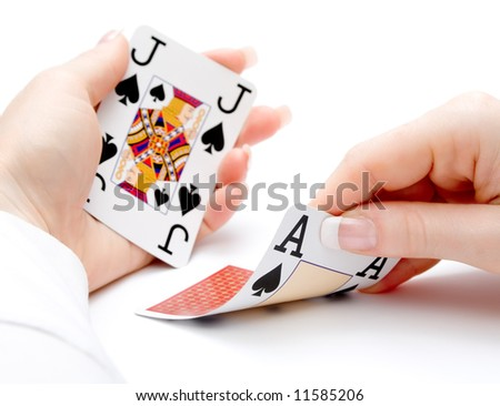 woman hands holding cards with 21 combination - blackjack - focus on the ace being drawn - stock photo