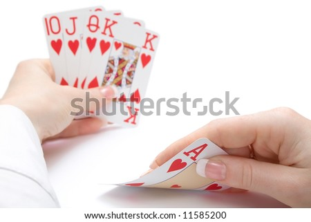 woman hands holding cards with royal flush poker combination - the ace is focused