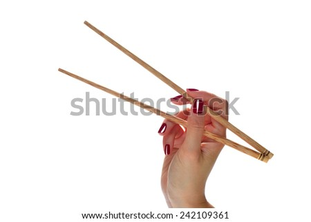 Woman hands holding chopsticks isolated on white