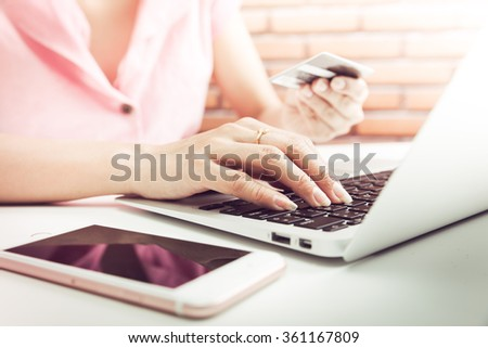 Woman Hands holding credit card and using laptop. Online shopping - stock photo