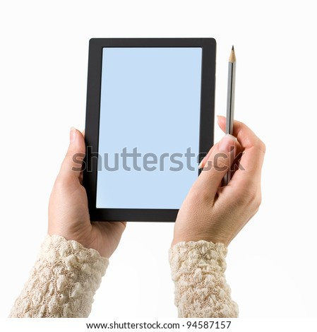 Woman hands holding electronic digital frame with blank screen. - stock photo