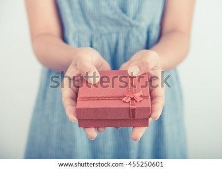 Woman hands holding gift box give for christmas or new year congratulation.  - stock photo