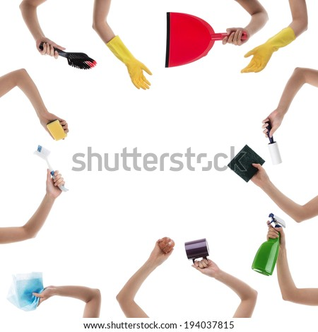 woman hands holding many  different house hold object mostly cleaning products - stock photo