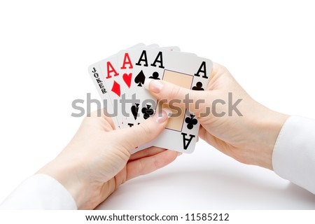 woman hands holding playing cards with four aces and a jocker combination - stock photo
