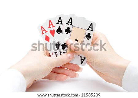 woman hands holding playing cards with four aces combination - stock photo