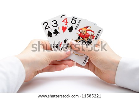 woman hands holding playing cards with poker straight combination and a joker - stock photo