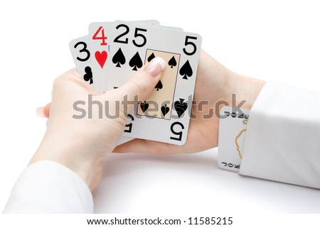 woman hands holding playing cards with poker straight combination and a joker up the sleeve - stock photo