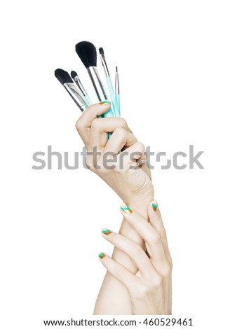 Woman hands holding set of professional make-up brushes isolated on white background