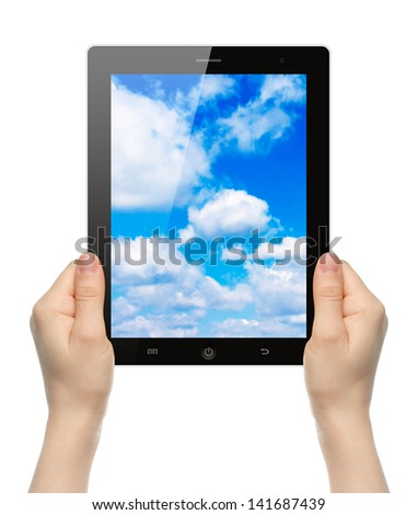 Woman hands holding tablet PC with sky on white background   - stock photo