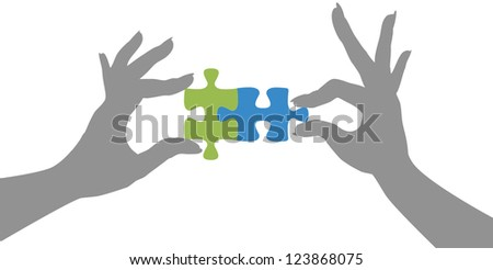 Woman hands holding two jigsaw puzzle pieces together to find a solution - stock photo