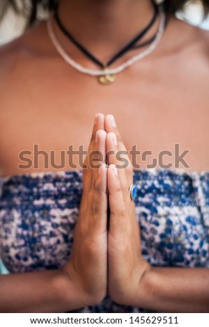 Woman hands in Namaste prayer mudra. Symbolic or ritual gesture in Hinduism and Buddhism - stock photo