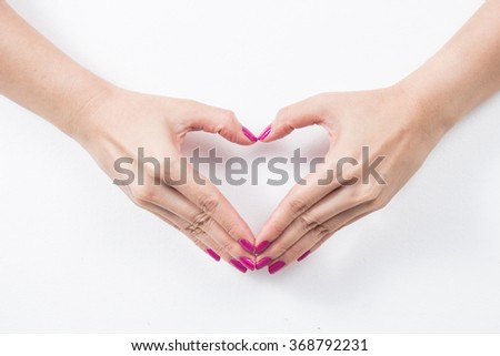 woman hands in the form of heart isolated on white background - stock photo