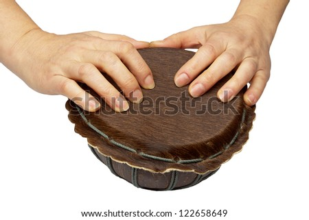 Woman  hands is on drum isolated on white - stock photo